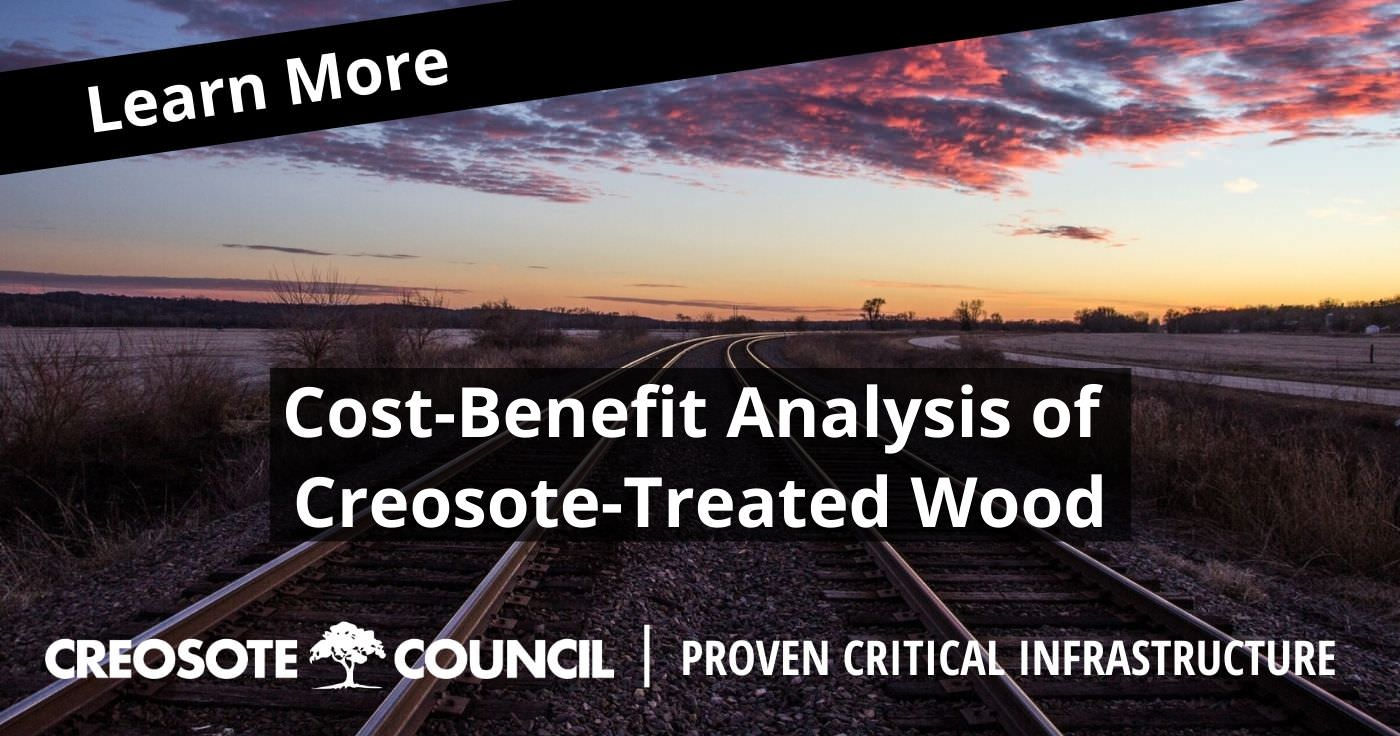 creosote-treated wood benefits - graphic of railroad tracks at sunset